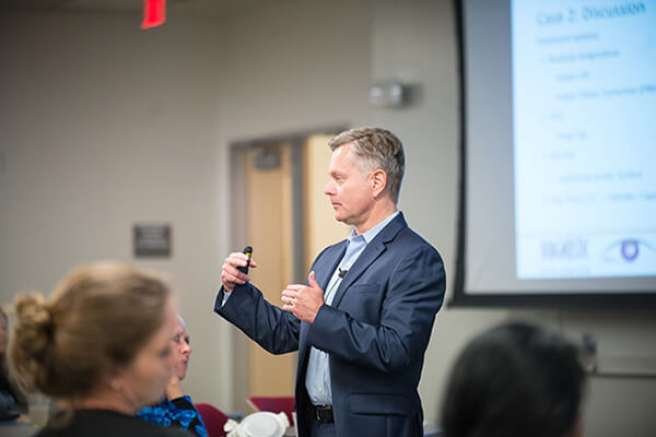 Dr. Marc Sanders Speaking at the Event