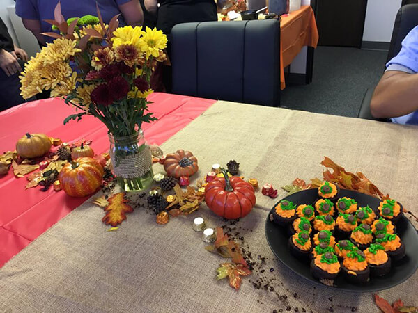 Pumpkins and Flowers on a table