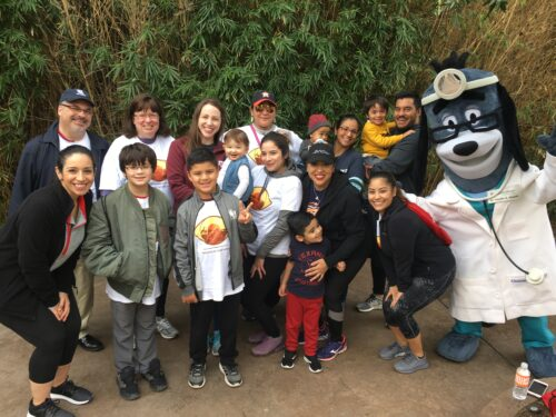 Group picture at Eye Stroll for Vision event with mascot.