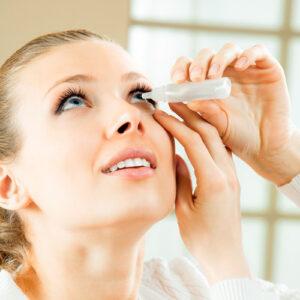 girl with eye drops
