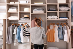 Woman selecting outfit from her closet