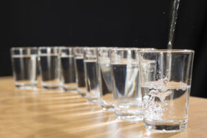 Glasses of water being filled