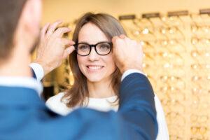 eye doctor fitting frames