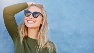 girl smiling wearing sunglasses