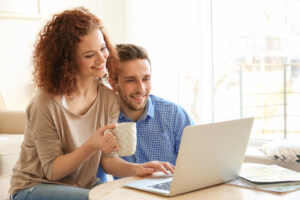 Man and Woman with coffee and laptop